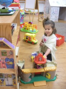 3 year old playing in the Before/After Care room